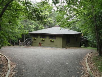 Cottage is on a wooded 1.5 acre lot