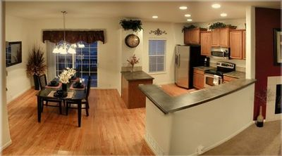 Hardwood floors, gourmet stainless steel appliances, granite dining room table