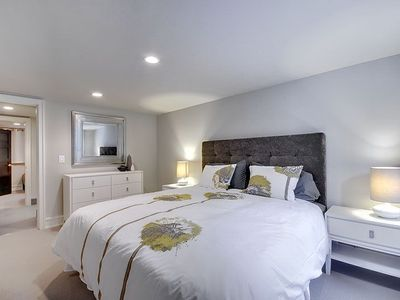 Lower Level Bedroom With King Sized Bed and Adjoining Bath