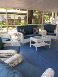 Screened porch - Wonderful large screened porch for gathering the family after a fun day at the beach.