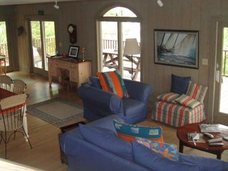 Living room/dining room with access to full deck - Folly Beach house vacation rental photo