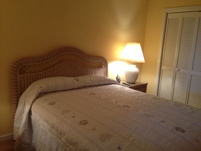 Guest room with Queen bed and wall mounted LCD TV