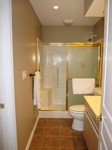 Sore knees? The adjoining guest bathroom is ideal with a step in shower.