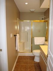 Branson condo photo - Sore knees? The adjoining guest bathroom is ideal with a step in shower.