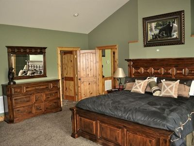 Large King Master Suite has room to lounge for some quiet time with lake views.