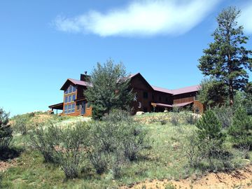 Peak View Lodge sits on 3 acres with incredible views in all directions