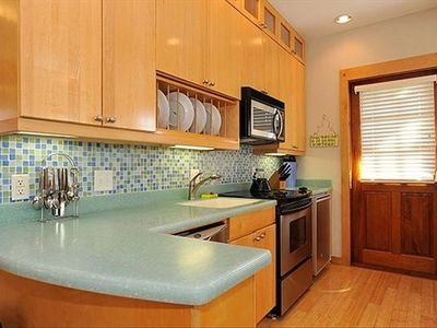 Spacious cheery kitchen.