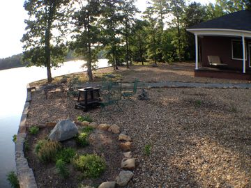 Fire Pit, 4 Chairs, 2 Chaises Lakeside. Double Chaise on Patio, Lake Surrounds