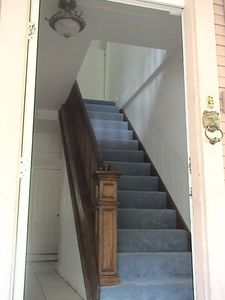Entry Hall with Oak bannister to second floor.