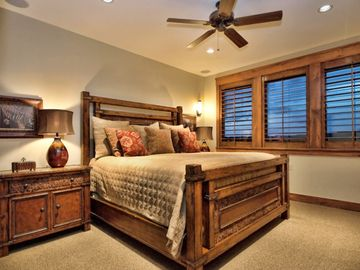 Another upstairs guest suite with King-size bed, attached full bath & lake views