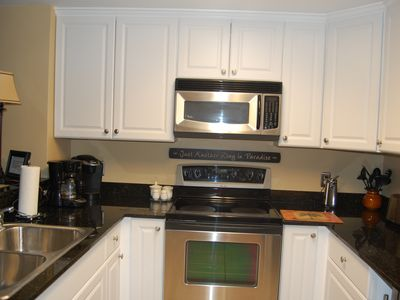 Full size kitchen with new cabinets and stainless steel appliances