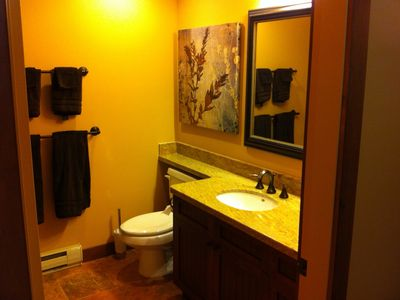 Partial view of second bathroom. It contains a combination bath/shower.