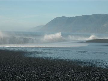 "short distance from "" black sands beach"""