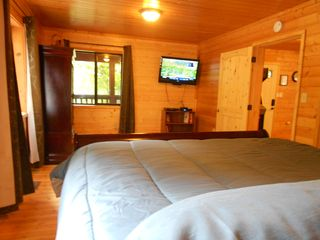 Pigeon Forge cabin photo - King MBR w Pillowtop Mattress, HD TV, Blu-Ray player, Armoire, Master Bath, etc.