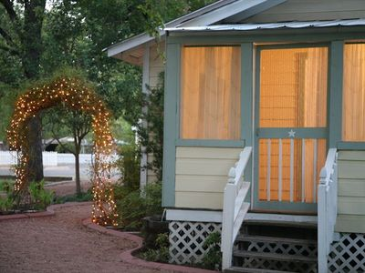 Beautiful lighted arbor path leads to your door.