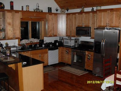 Fully equipped Kitchen. Plenty of counterspace, cabinet space and breakfast bar