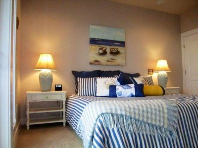 Master Bedroom with seaside decor, ensuite & private Oregon ocean view balcony