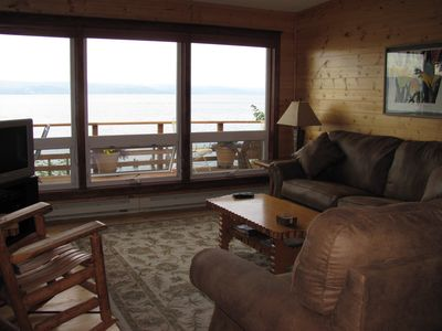 Living room with fold out queen couch, panoramic lake view