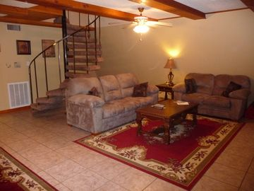 Warm, Cozy Family Room with Large Flat Screen TV and a Bar.