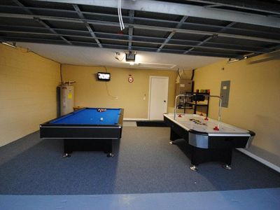 Games room with 22' flat screen TV, pool table & air hockey table.
