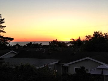 View at sunset from deck off master bedroom.