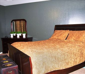Master bedroom with King bed and satellite tv