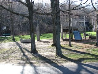 Lake Leelanau cottage photo - Kids will have hours of fun at the Play scape area.