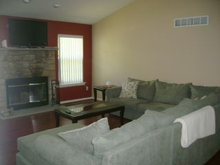 Shawnee house photo - Fire Place with large flat screen TV, DVD and Wii console available for renters.