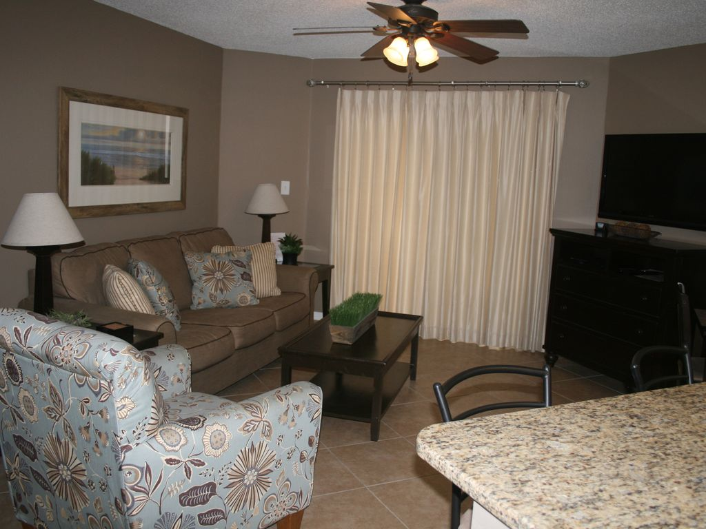 """Living room with 46"""" wall mounted TV, Media center with 3 drawers for clothes"""