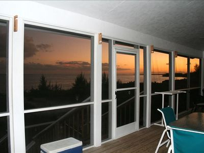 Sit back and enjoy the soft Island breezes from you 30' screened porch