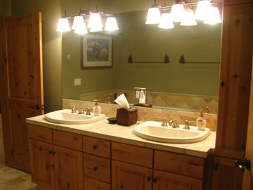 Large master bath with double vanity, heated floors, jetted tub, separate shower