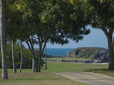 It's a brief walk down the cart path to the ocean, and the famed island hole