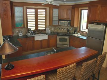 The fully equipped kitchen & bar is perfect for conversation while cooking.