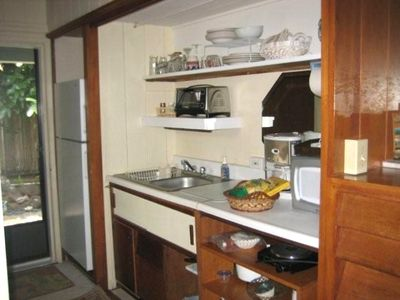 Picture of the kitchen with microwave, hot plate, coffee maker, rice cooker