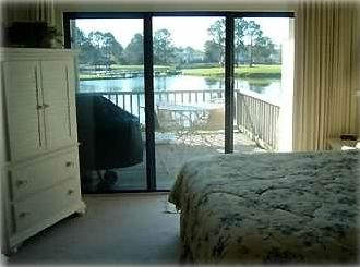 View from master bedroom over lake to 16th fairway on Links Golfcourse