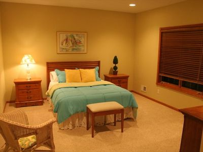 One of two lower level bedrooms with views of Crystal Lake