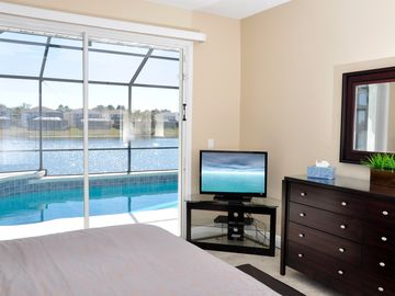 The Master Bedroom overlooking the Pool and the Lake