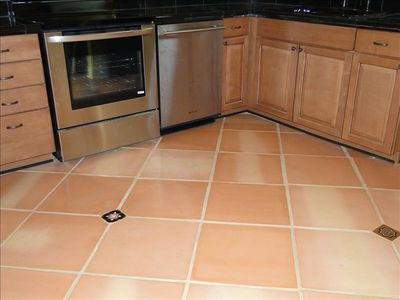 Beautiful Mexican satilla tile floors with talavera accent tiles