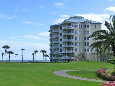 Amelia Island condo rental - Looking across the Ritz-Carlton lawn to our oceanfront condo building.