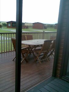 DECKING VIEW WITH TABLES AND CHAIRS
