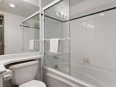 Bathroom with bath and shower.