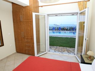 Skala villa photo - Main floor Bedroom. Straight outside your pool
