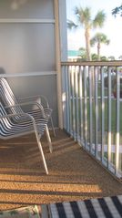 Sanibel Island condo photo - back screened lanai with pool and partial gulf views