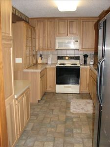 Completely furnished kitchen w/ tile floors and space to serve a large group.
