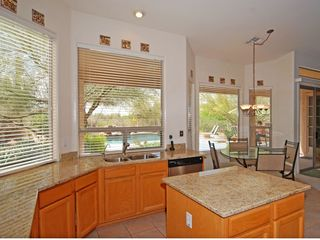 Scottsdale North house photo - Fully equipped kitchen looks out to the pool