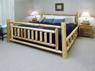 Traverse City condo photo - Master Bedroom w/Pine Log King Bed, Walk-in Closet, Flat Screen TV