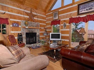open, spacious livingroom with fireplace and cozy furniture to relax in