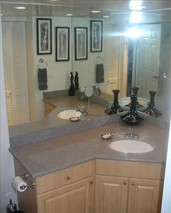 Our newly designed bathroom includes more counter space and large mirrors.