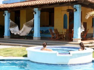 Pochomil house photo - Enjoy the pool while your friends relax in the hammocks or play ping pong