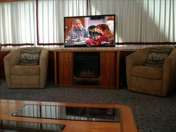 "46"" TV with Electric Fireplace below"